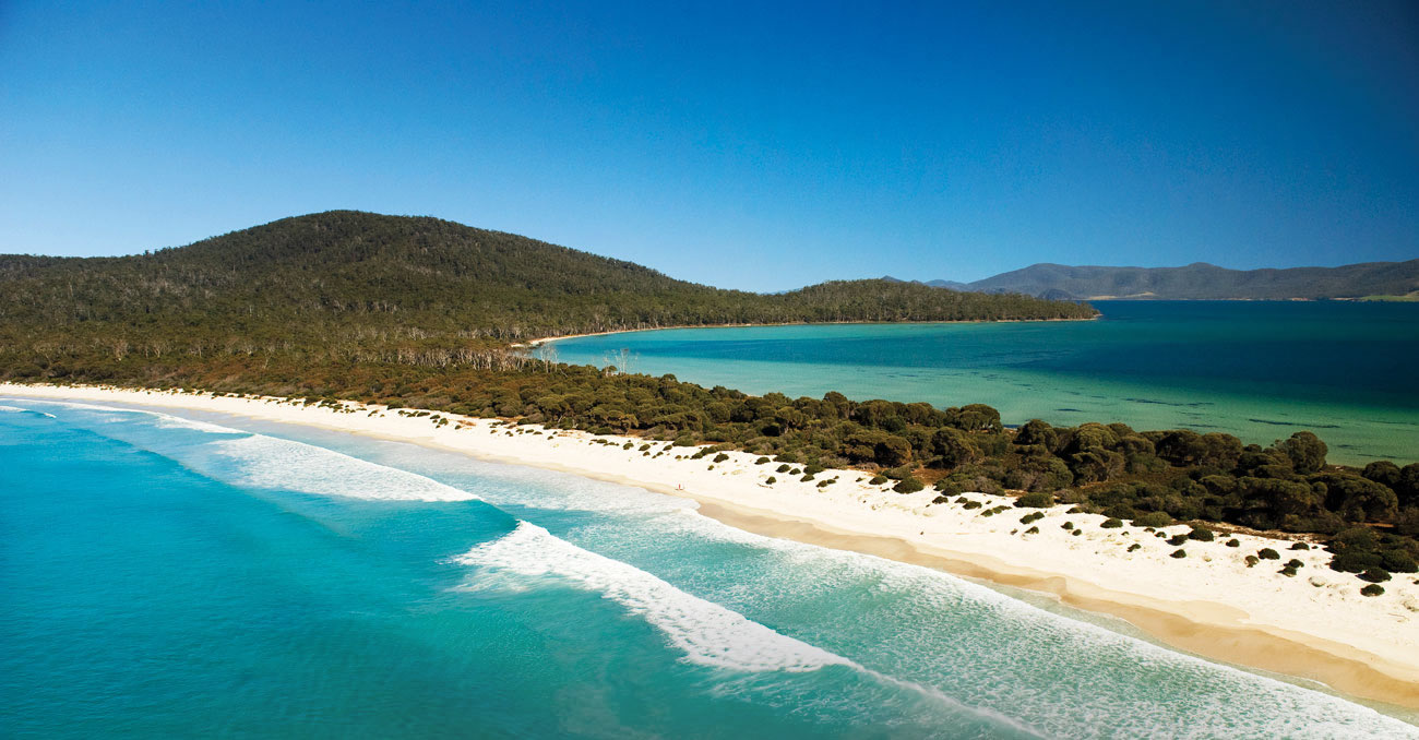 Guests walking along the isthmus, The Maria Island Walk